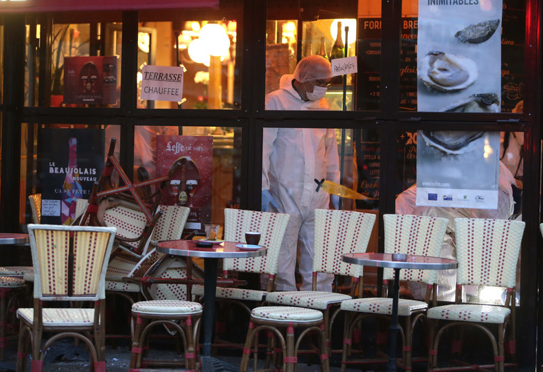 Forensic police search for evidences inside the Comptoir Voltaire cafe at the site of an attack on November 14, 2015 in Paris, after a series of gun attacks occurred across the city. AFP PHOTO / KENZO TRIBOUILLARD (Photo credit should read KENZO TRIBOUILLARD/AFP/Getty Images) (KENZO TRIBOUILLARD / AFP/Getty Images)