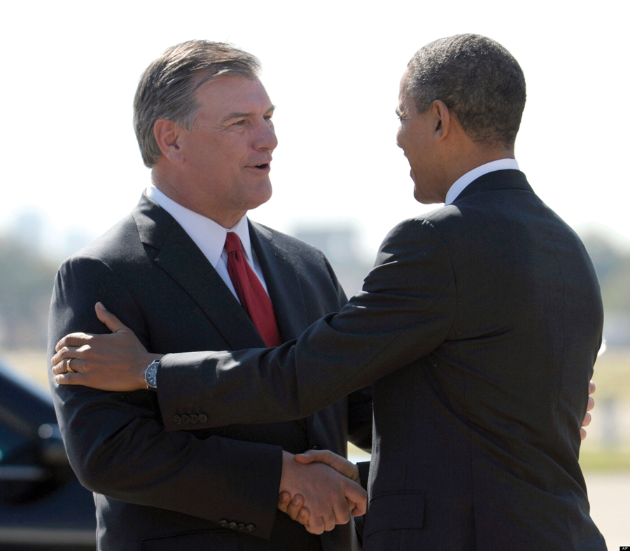 President Barack Obama shakes hands with Dallas Mayor Mike Rawlings after arriving at Love Field in Dallas, Tuesday, Oct. 4, 2011. Obama is attending fund raisers in Dallas and will speak at Childrenís Laboratory School at Eastfield College in Mesquite, Texas., on the American Jobs Act. (AP Photo/Susan Walsh)